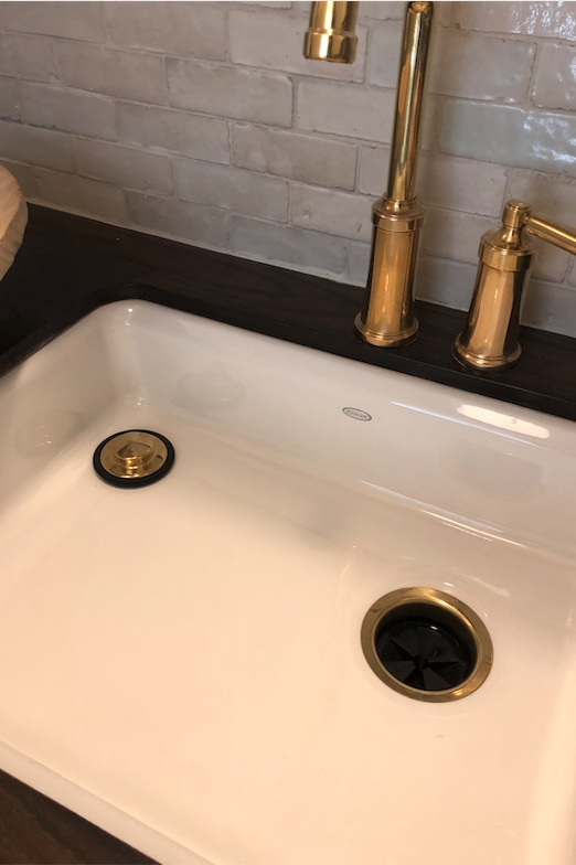 Kallista entertainment faucet  in unlaquered brass and  Kohler  sink.