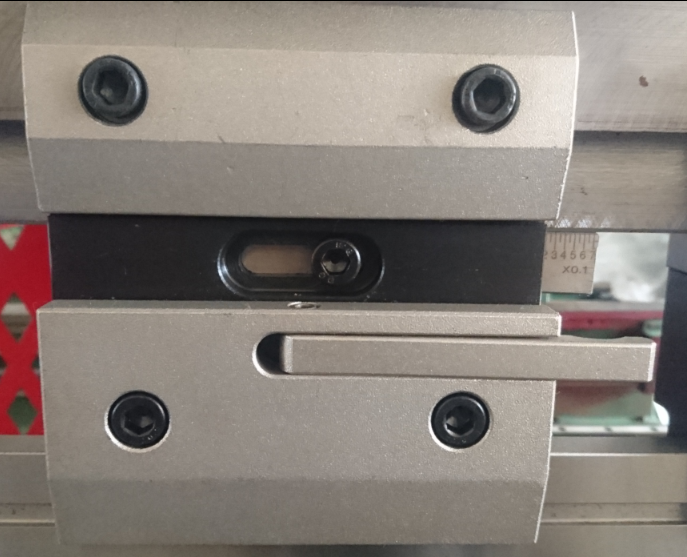 Quick release clamp system, showing the wedge adjustment and centre screw placement.