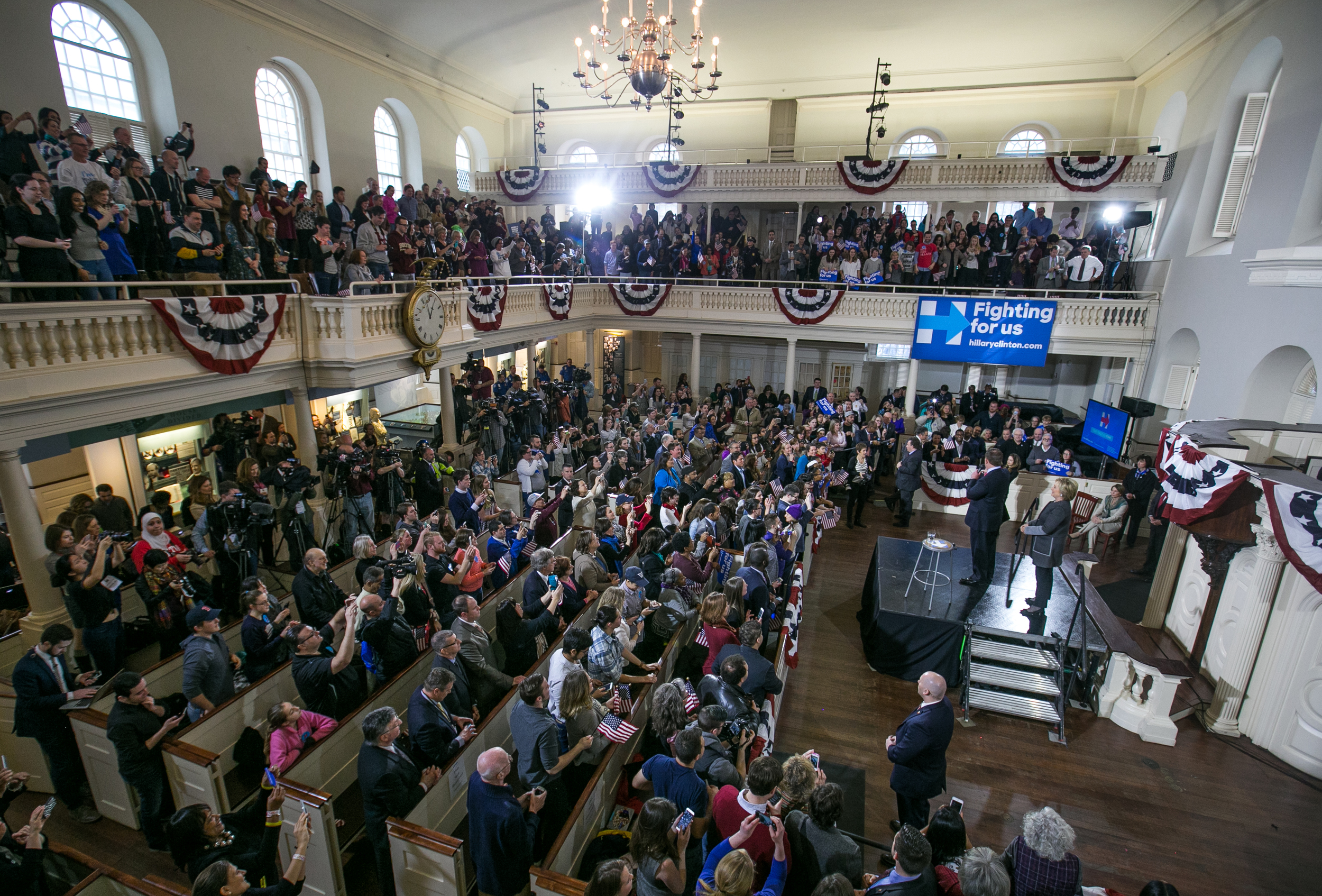 "February 29, 2016 - Voters filling the historic seats of the Old South Meeting House cheer during former Secretary of State Hillary Clinton's rally on the final morning before Super Tuesday. During the address, Hillary spent little time talking about her opponent (Senator Bernie Sanders D-Vt.), and instead focused on issues like college tuition. ""I do not want to ask you to pay taxes to send Donald Trump's youngest son to college,"" Clinton said as the crowd roared in approval.  ©Mike Schwarz"