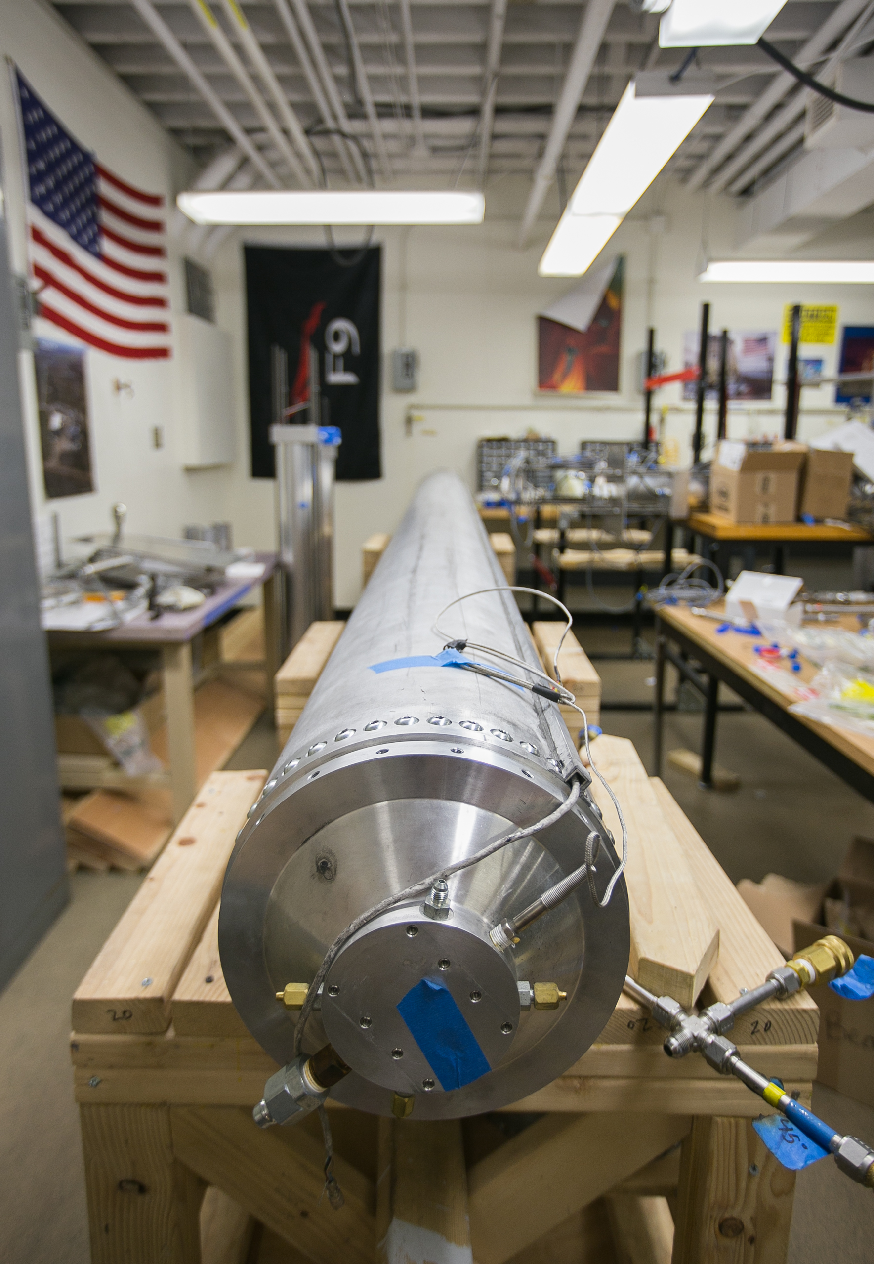 March 29, 2016 – The Starscraper rocket awaits it's 2017 launch in the lab of the Boston University Rocket Propulsion Group. The rocket is 30 feet long and weighs roughly 1200 pounds. It will require the assistance of two liquid bi-propellant Lotus engines to make it to space. The Boston University team is in a tight race with the University of Southern California to be the first student designed and constructed rocket to reach space – or about 62 miles above the earth's surface.   ©  Mike Schwarz