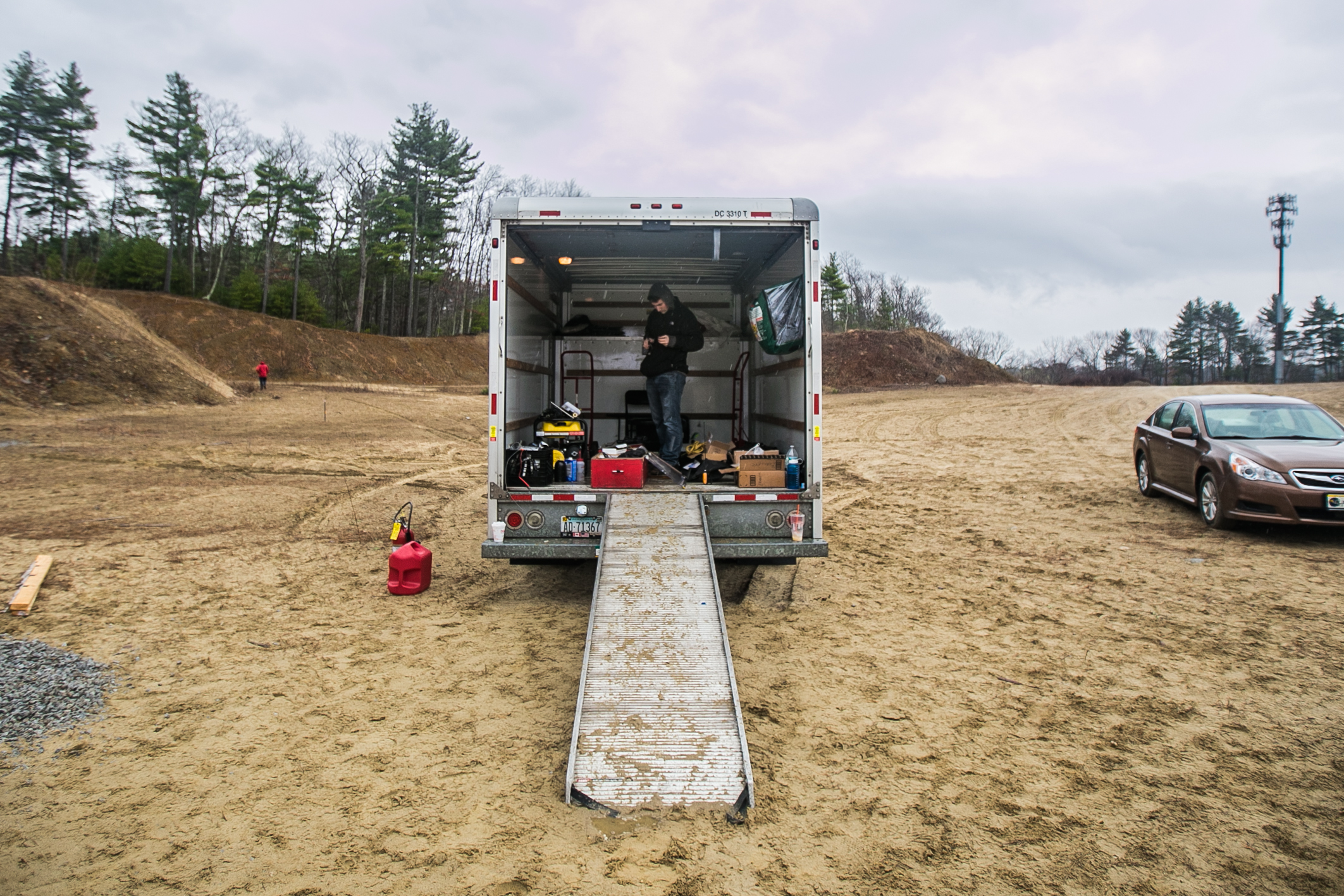 April 2, 2016 – Doug Lescarbeau, of the Boston University Rocket Propulsion Group, grabs supplies from the U-Haul truck during a test run of the liquid bi-propellant Lotus engine. The rocket development team established a safe testing site in the town of Sudbury, Mass. about 35 minuets outside of Boston. Over the past four years they have conducted over 20 engine tests at this location, and plan to reach space by the summer of 2017. Two of the Lotus engines will eventually be installed on the Starscraper, a 30 foot 1200 pound rocket, and launched from the Black Rock Desert in the summer of 2017. The Boston University team is in a tight race with the University of Southern California to be the first student designed and constructed rocket to reach space – or about 62 miles above the earth's surface.   ©  Mike Schwarz