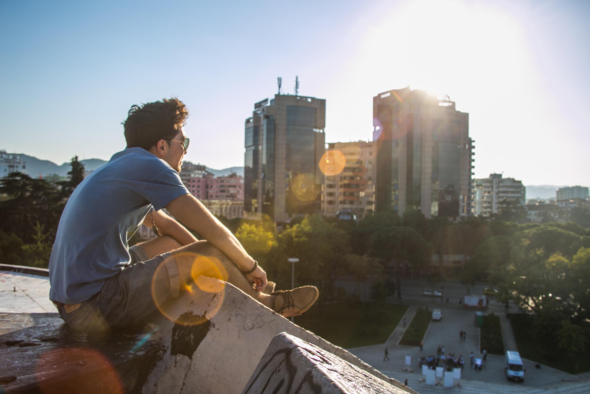 Marco sitting atop the Pyramid of Tirana.