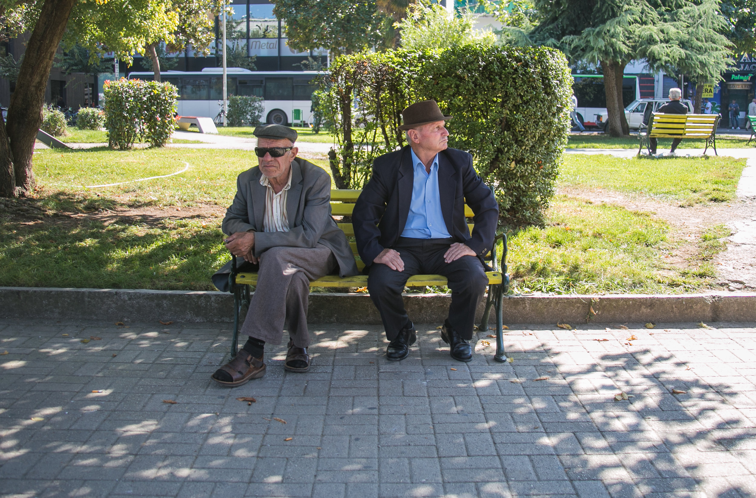 Two Albanian men sitting on a bench in Tirana.