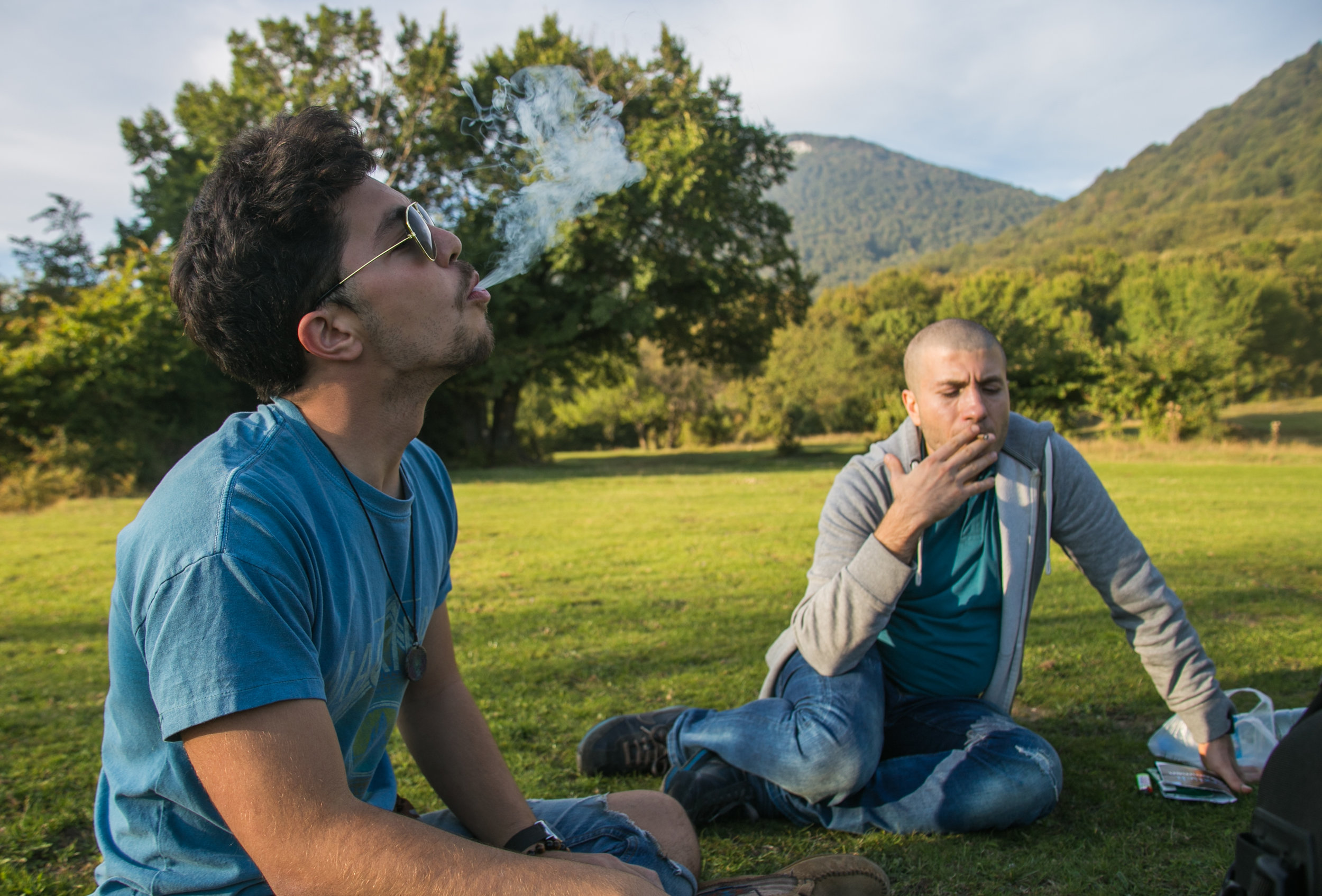 Marco and Mo smoking hand-rolled cigarettes atop Dajti Mountain.