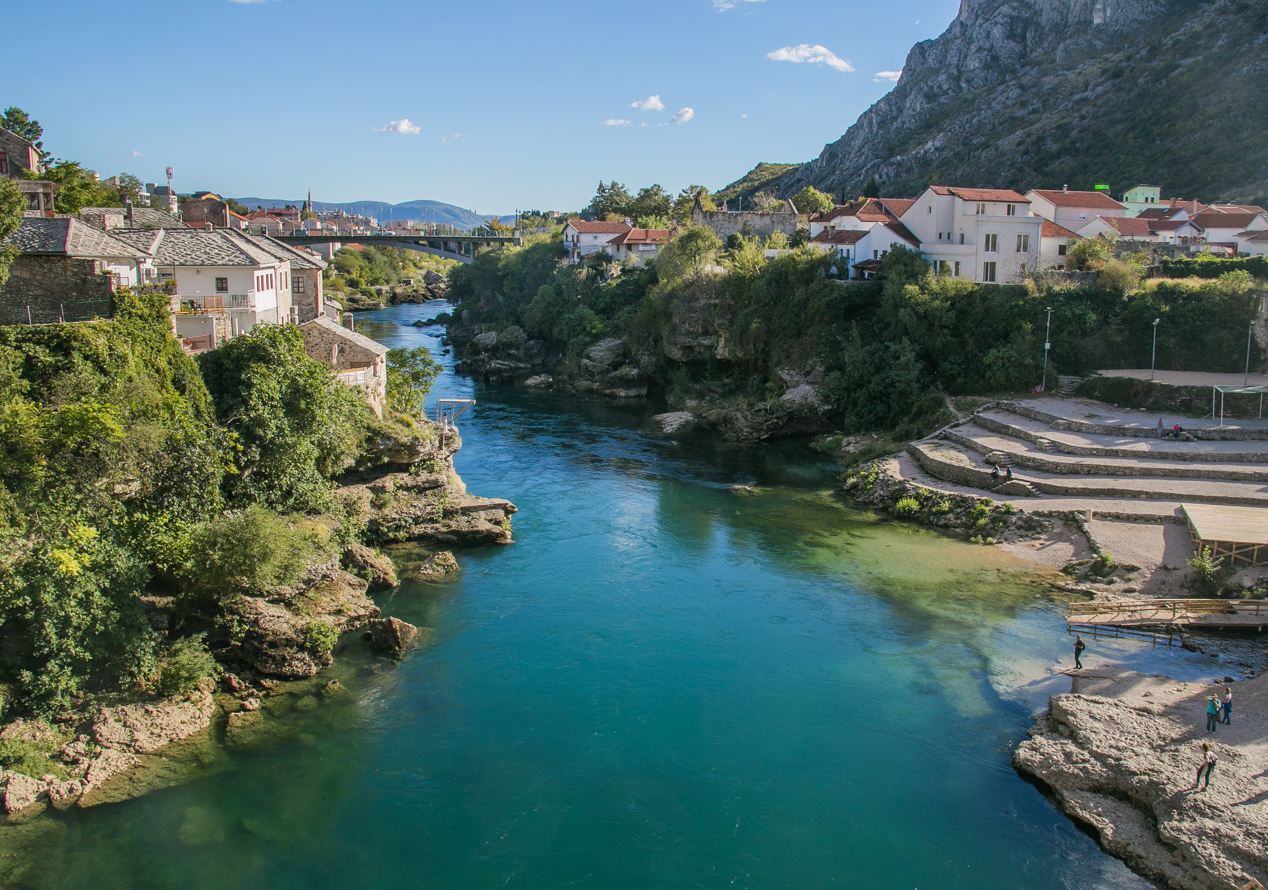 The Radoblja River weaves through the city of Mostar, Bosnia. The small diving board on the left riverbank is used as a practice grounds for the Bosnian diving team. For 30 euro you can complete a training course and jump off the over 70-foot historic Old Bridge where this photo was taken.