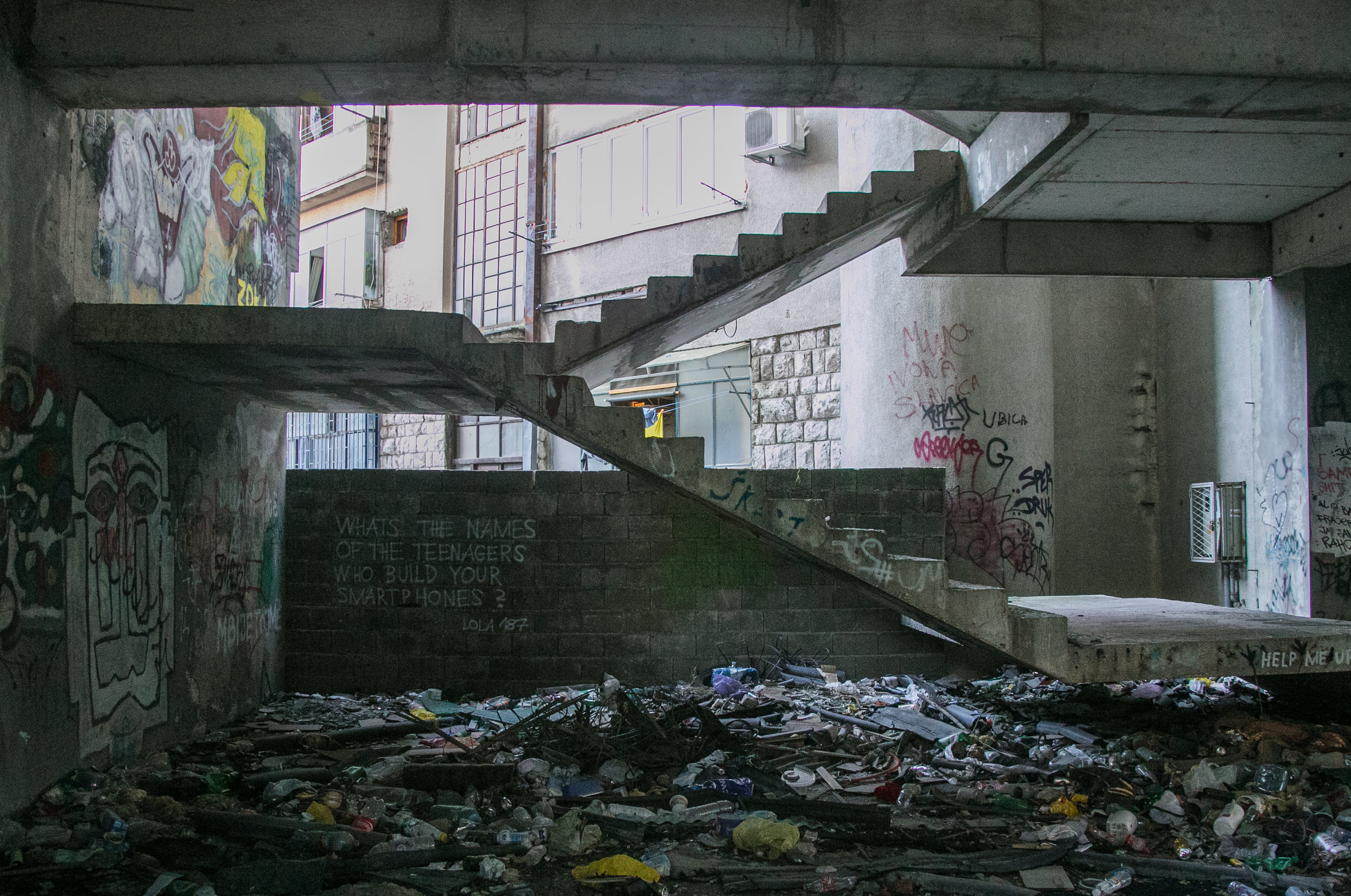 The now railing-less stairs to an abandoned sniper tower left over from the Bosnian War in Mostar, Bosnia.