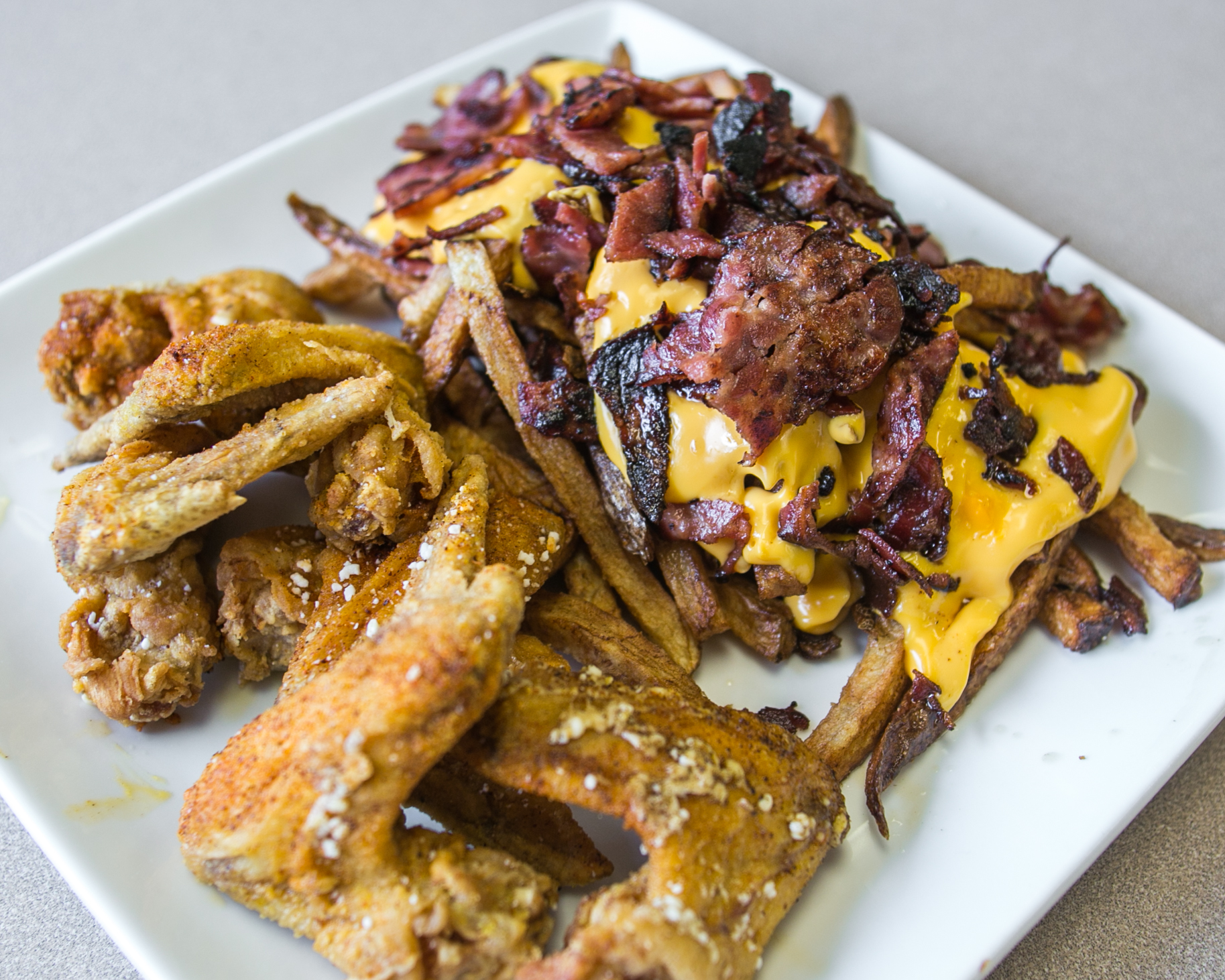 Shuman's Homewood_Fried Chicken Wings with Beef Bacon Cheese Fries_native_-3.jpg