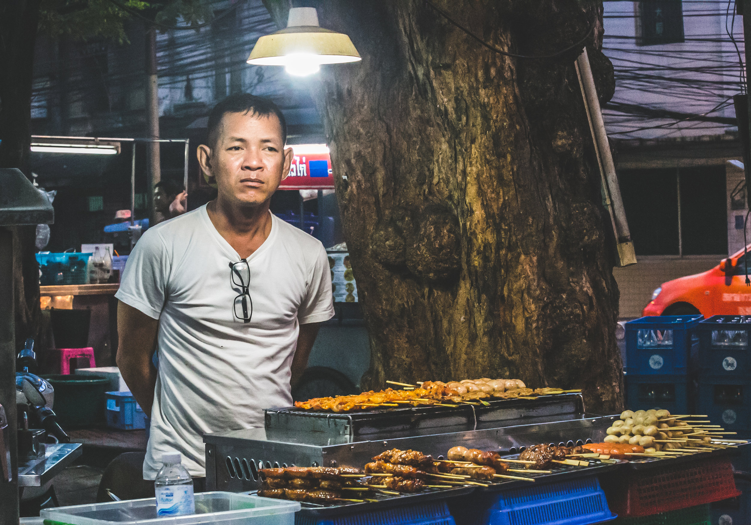 Nipon, a 48 year old street vendor in downtown Bangkok, sells assorted grilled meats on a busy street corner. Nipon fought hard for the rights to this location, and makes a great return on his investment. Each day he makes around 3,000 baht ($95usd), an impressive daily wage for Bangkok.