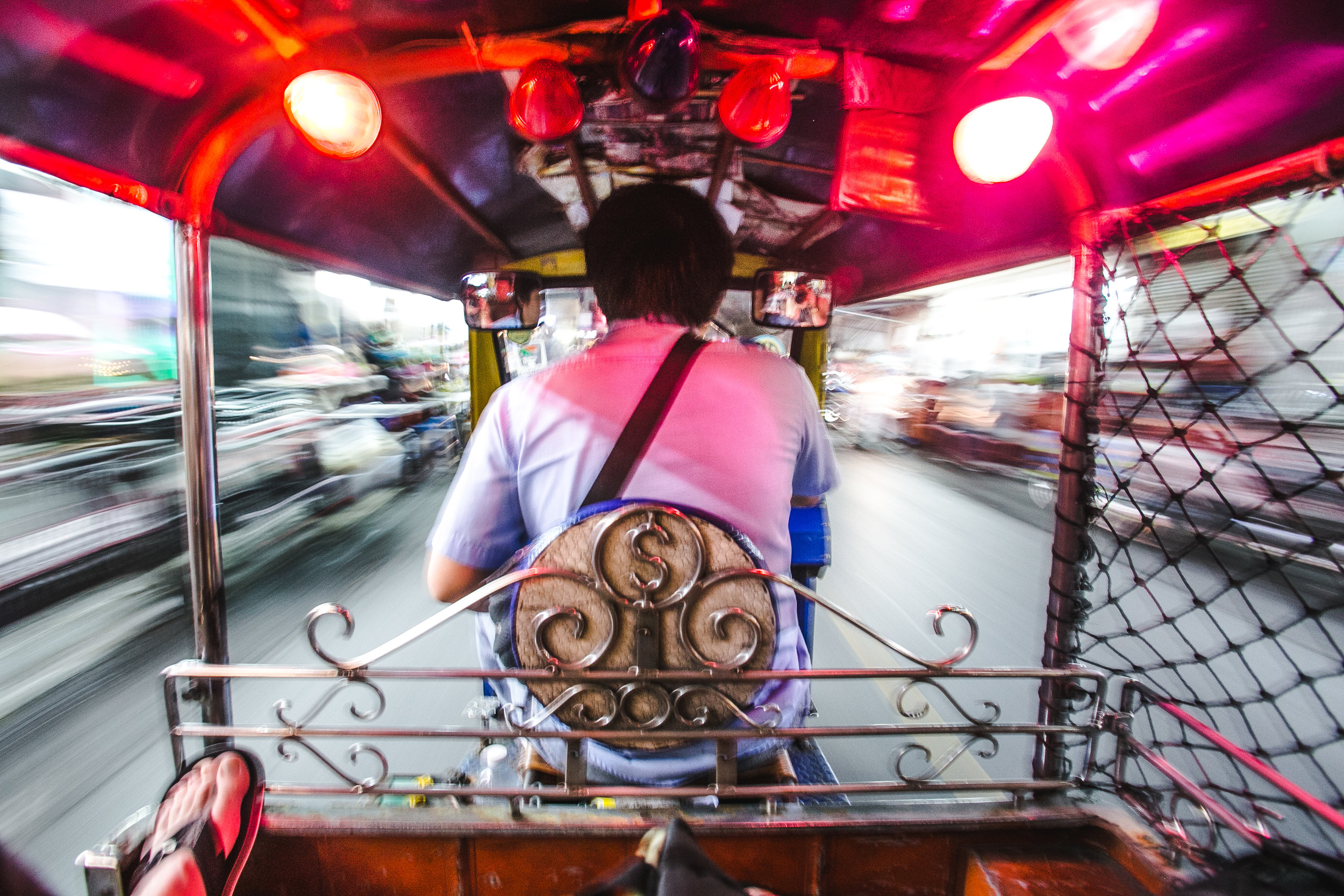 "1:05am -  Likto, 28, drives through the Khlong Tan Nuea District in Bangkok. He has been driving for 10 years, and says he enjoys it. ""Some day the money very good, some day very bad. I like it though, good job here in Bangkok."" Likto's father owns the cart - which he and his brothers share during the week. The cart cost his family around 200,000 baht ($6300usd), and Likto makes between 500-800 ($10-20usd) baht per night on average. On this day, he had been driving for 10+ hours, and made 300 baht ($10usd)."