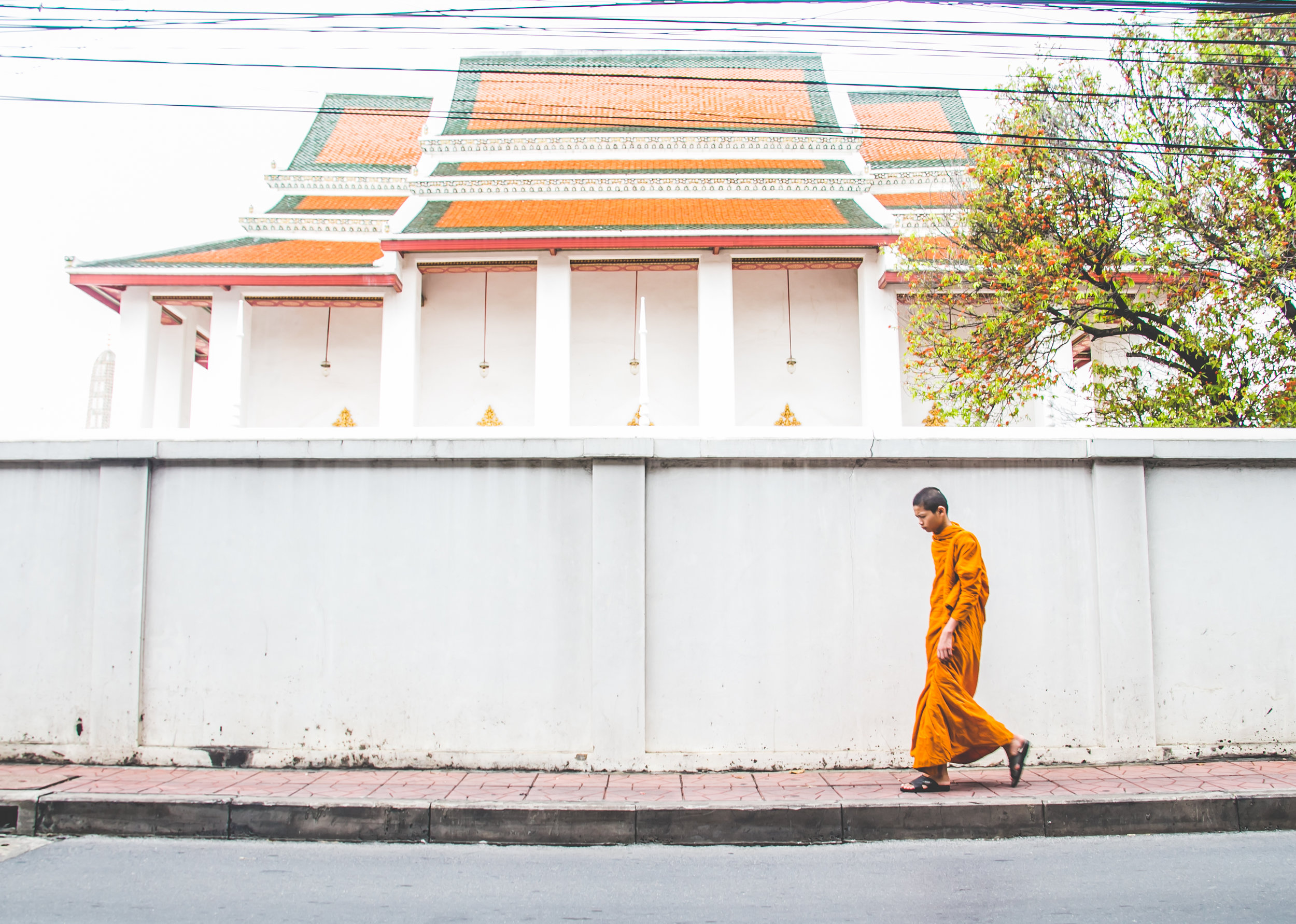 A monk walks outside the Wat Thepthidaram Monastery in central Bangkok.