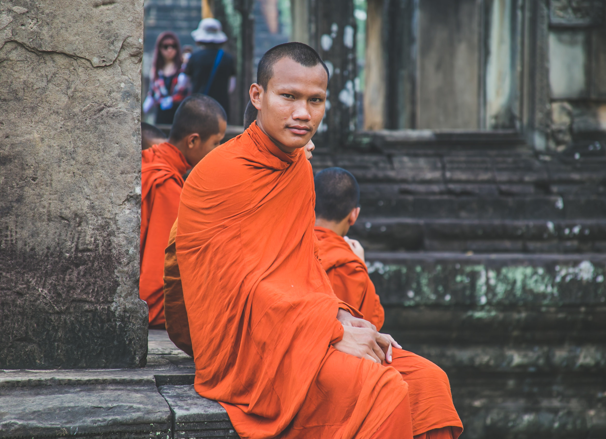 Unlike Thai monks, Cambodian boys like Yun can start practicing as early as age 6 - becoming an ordained monk at 20. Buddhist monks occupy their own social class in Cambodia. They are pillars in the community, and participate in festivals, religious ceremonies, marriages, and funerals.  Each village has a spiritual center, or wat, where 5-70 monks reside depending on the town's population. Woman are also permitted to become nuns at an older age - often after becoming widowed. They shave their head and eyebrows, live with the monks, and play an important role in the wat's daily happenings. Together these revered individuals service Cambodia's 95% Buddhist population.