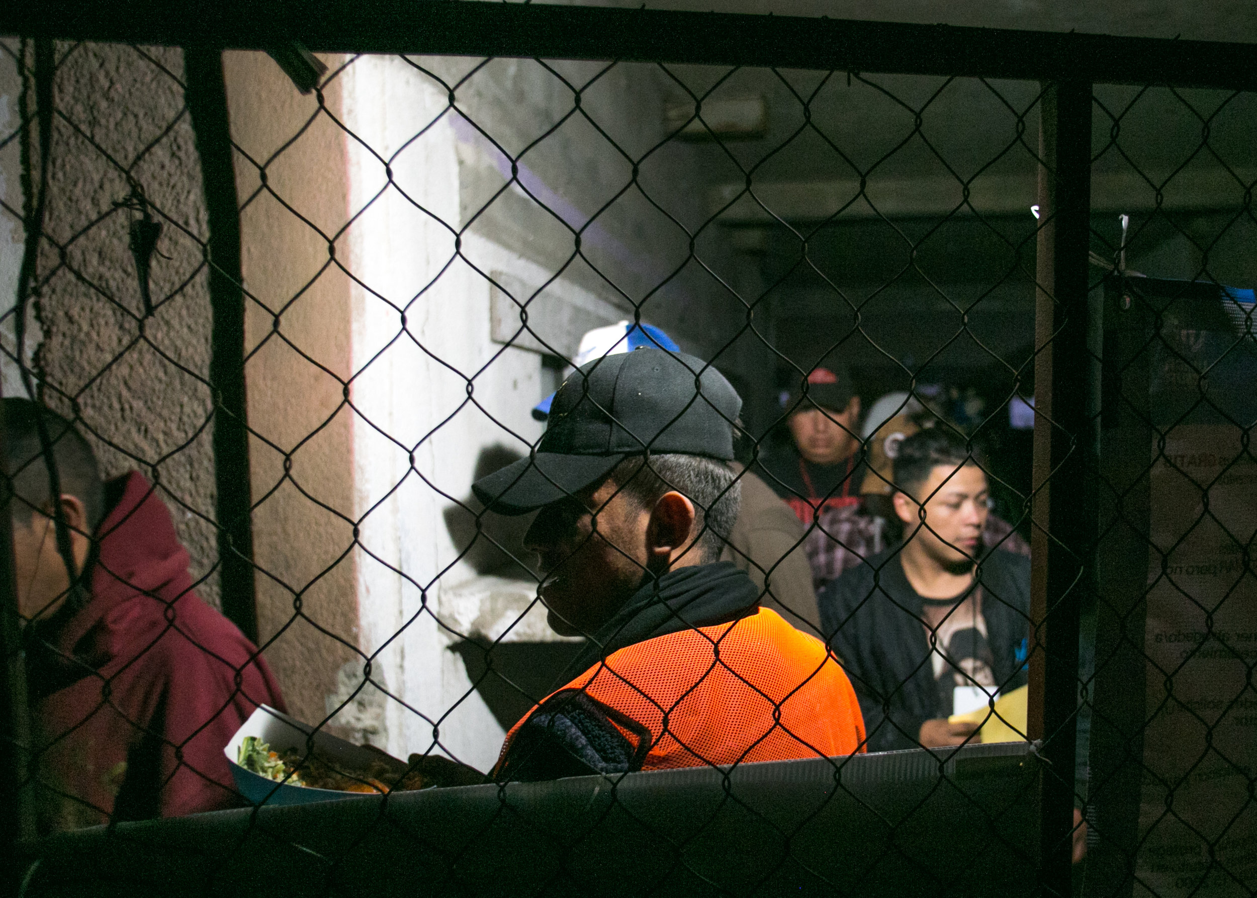 Refugees from the male portion of the compound eagerly wait their turn to enter the family side of the facility for dinner. Each night World Central Kitchen served between 1,200 and 1,500 meals. The line stretched over 100 yards in the other direction.