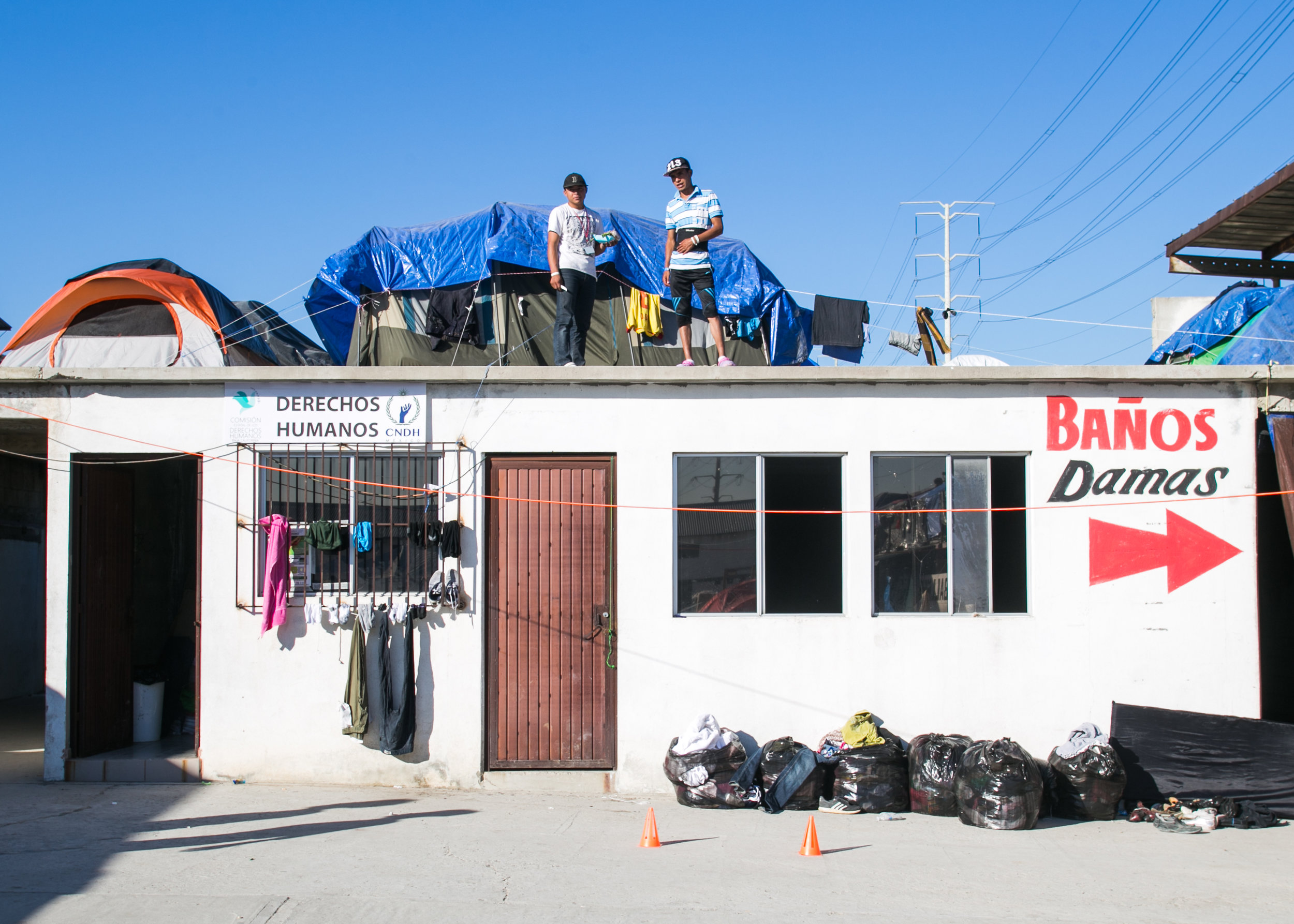 Tents are packed into every section (even on the rooftops) of the overcrowded Barretal refugee camp located outside of Tijuana, Mexico.