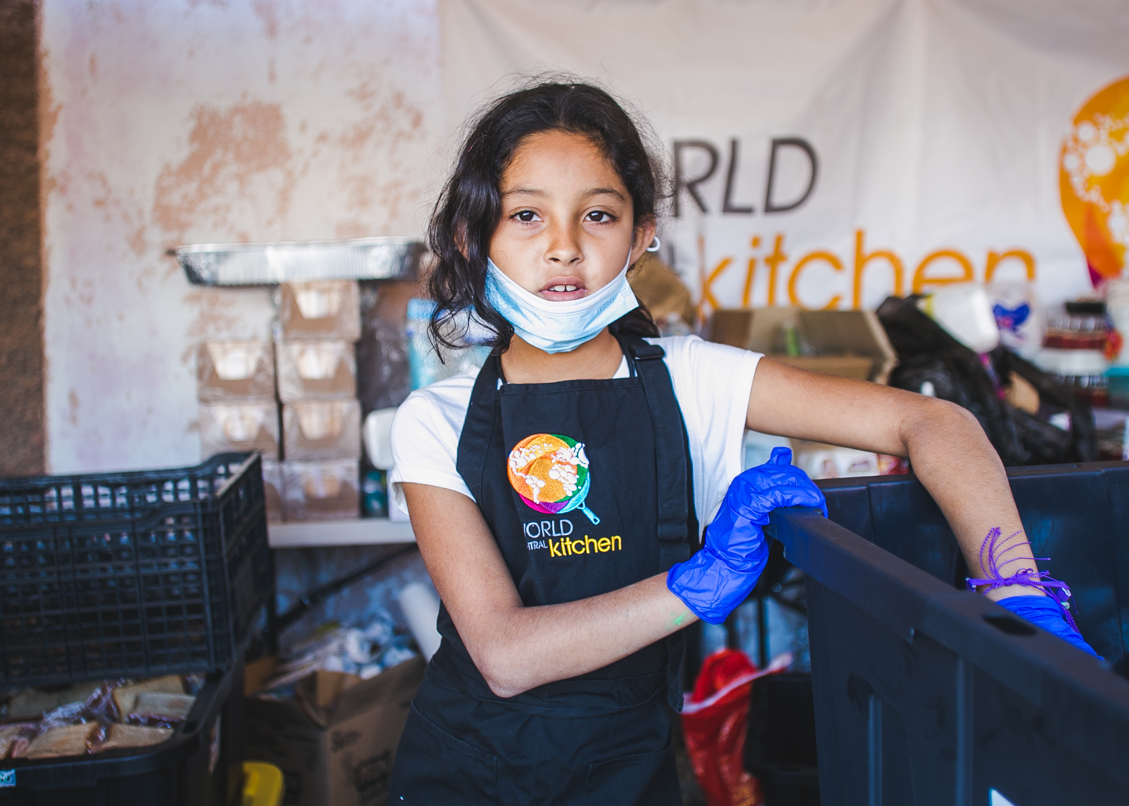 A refugee and kitchen volunteer serves lunch to over 1,500 at the Barretal camp in Tijuana, Mexico. Each day, 5-6 children from the camp assist World Central Kitchen with serving lunch and dinner. The goal of the program surrounds creating a sustainable refugee-operated kitchen in Tijuana to serve for months (or even years) to come. The recent influx in caravan activity has drawn mass media attention - but contrary to popular belief - refugees from Central America have been arriving in Tijuana for over a decade.