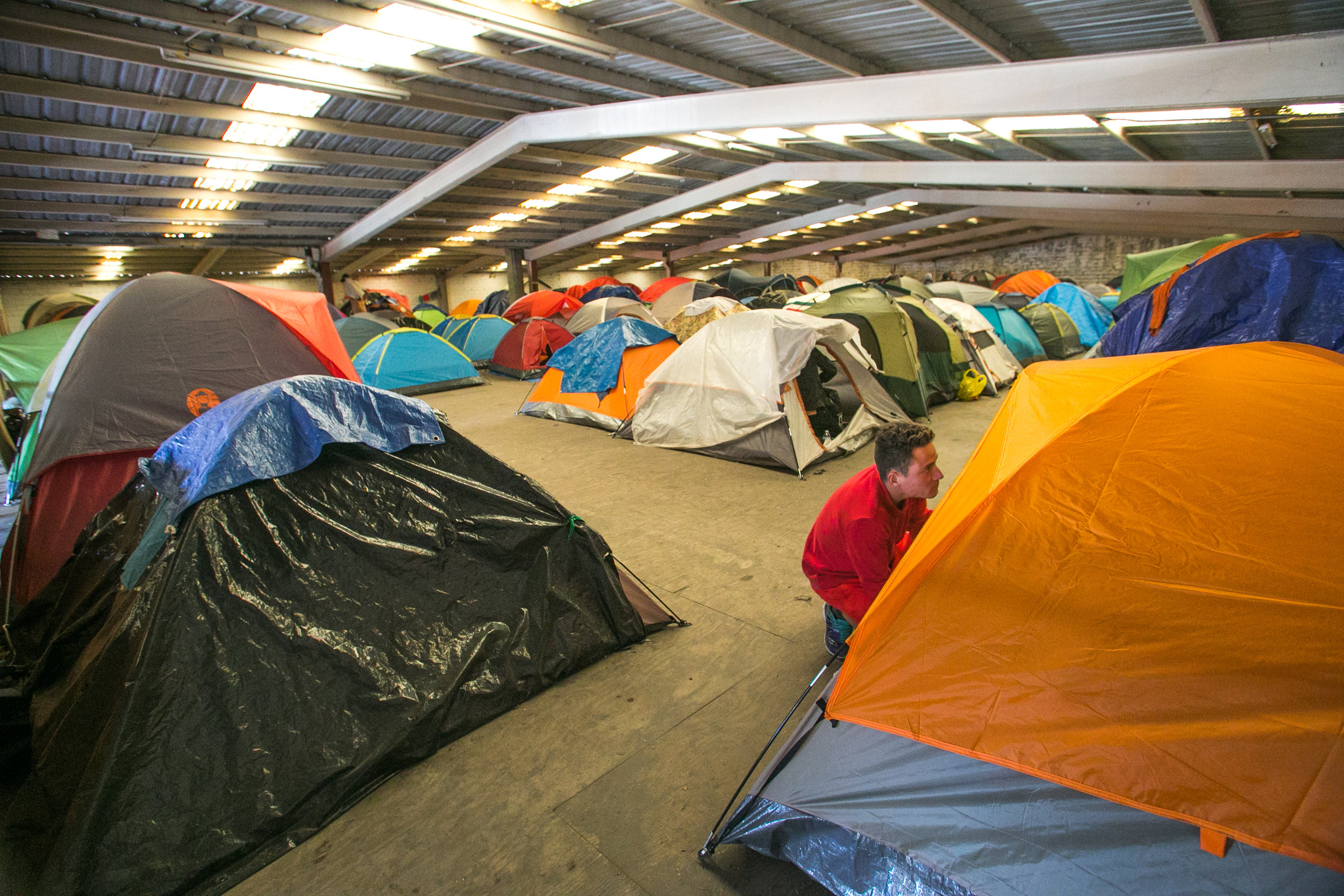 Tents line the second story of the El Chinchetta refugee compound in Central Tijuana. The building is home to 300-400 Central American migrants. Due to complaints from local residents, all medical, food, and donation services were suspended last week in an effort to re-locate the refugees, and close the facility.