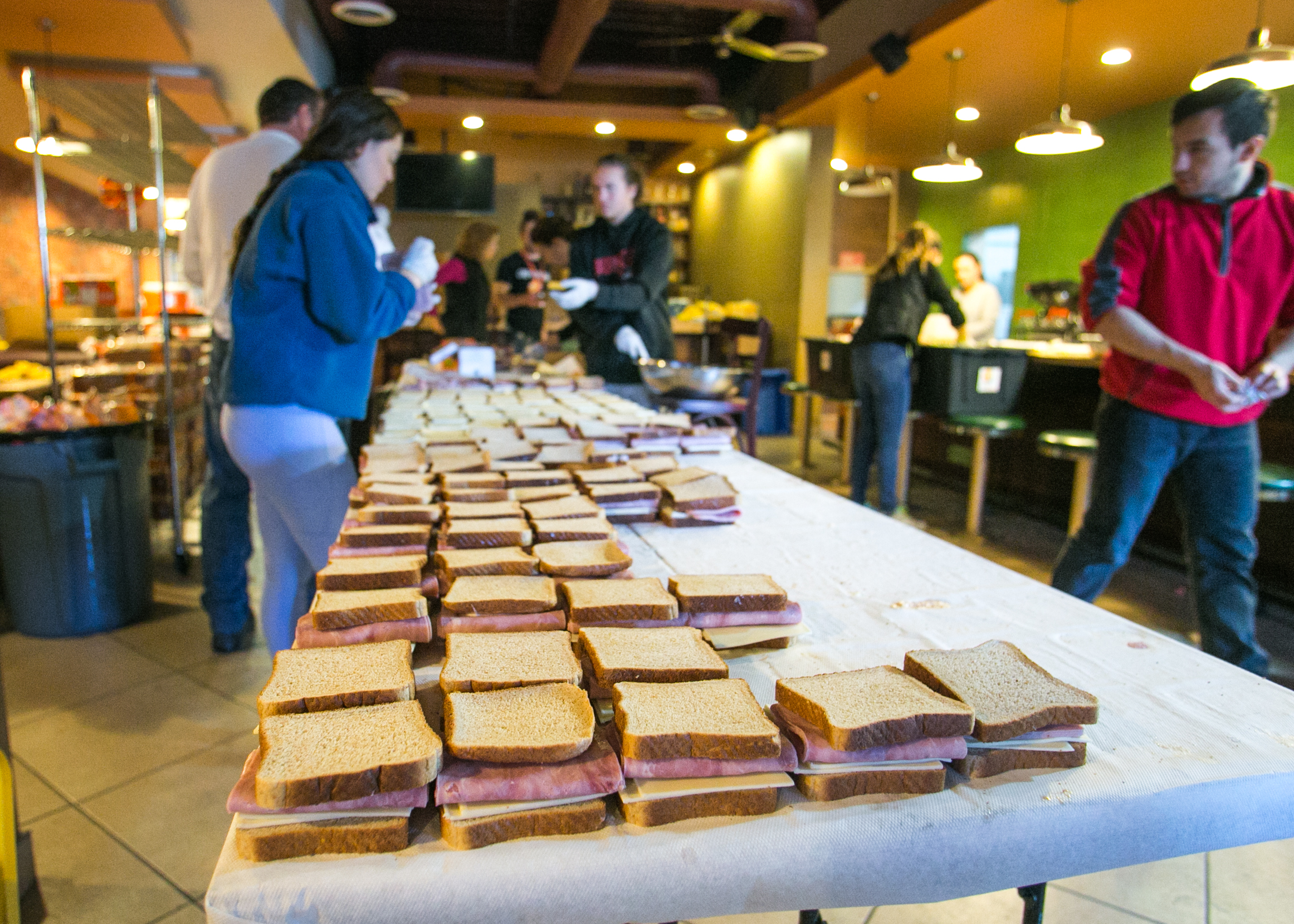 Over 1,200 sandwiches are prepped for lunch by World Central Kitchen volunteers.