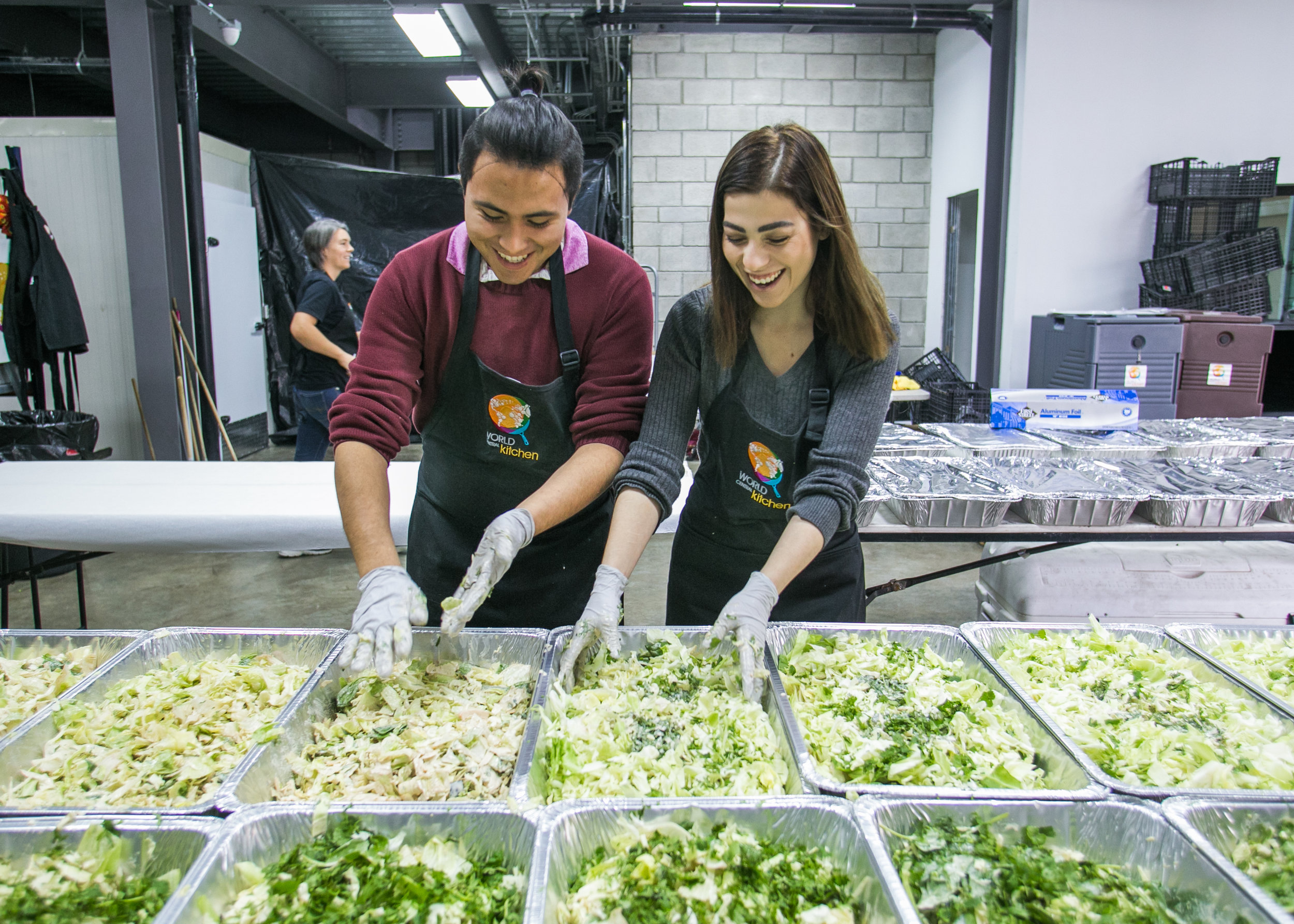 Oscar Montana, a volunteer from a local Tijuana university, prepares dinner at the World Central Kitchen Headquarters.
