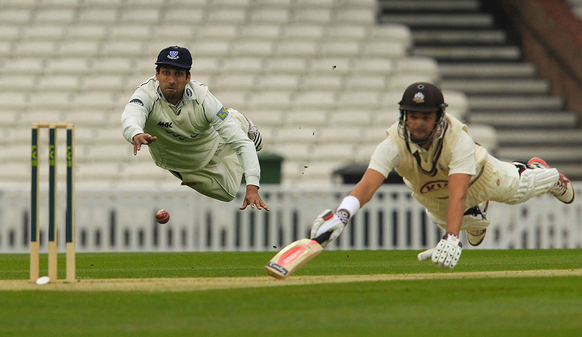 Sussex bowler Amjad Khan attempts a run out as Jack Ruddolph dives to reach his ground