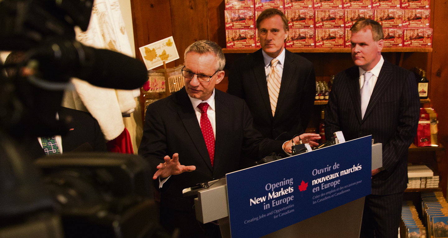 Ed Fast, Minister of International Trade, gives details of a cross-Canada tour to promote the benefits of the Canada-EU trade agreement while John Baird, Minister of Foreign Affairs (right), and Maxime Bernier, Minister of State (Small Business and Tourism, and Agriculture), look on. Deb Ransom