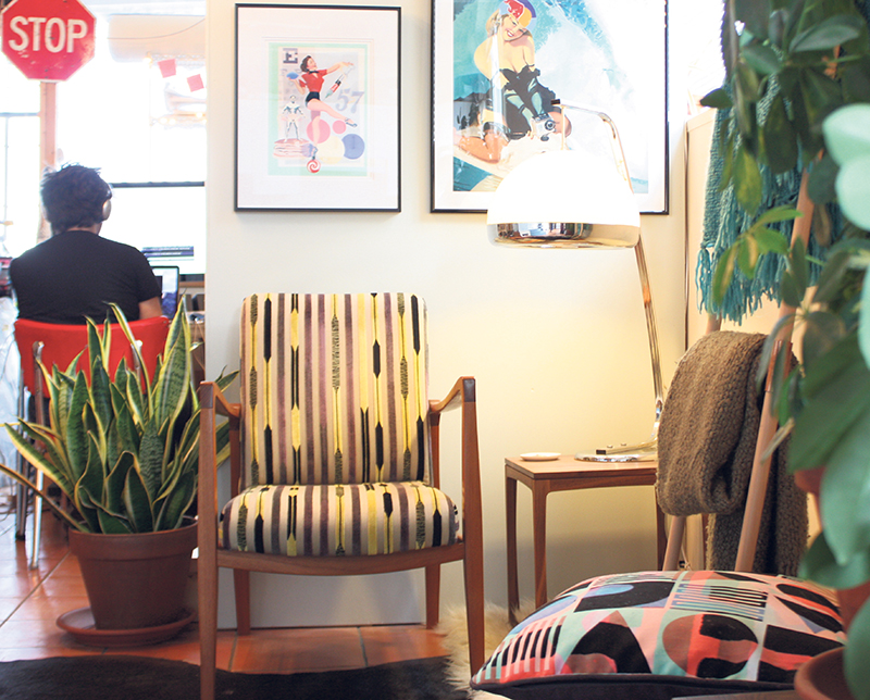 Two work spaces and an office in a 1,000-square-foot home studio? Wood artisan Meredith Nicole and artist Mark Henderson (her Finn chair and prints of his large-scale paintings, bottom) make it work. Jennifer Shanse