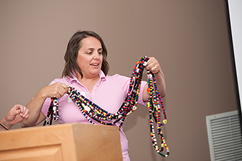 Liset Stanton holds up her son Daniel's 'bead story' – each bead representing a step toward recovery from leukemia: a bead for each blood transfusion, a bead for each round of chemotherapy, a bead for the stem cell transplant. supplied