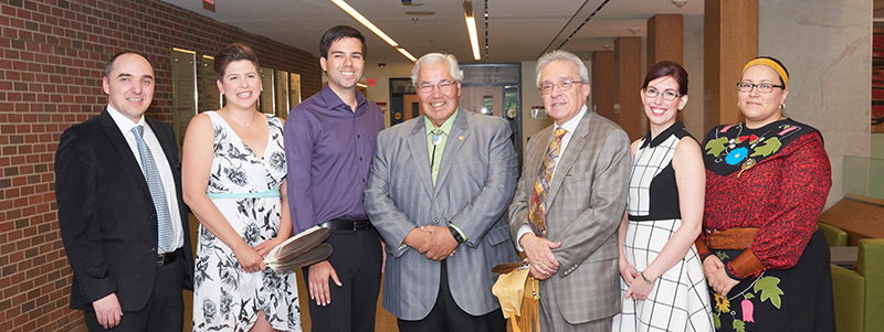 Osgoode Hall Law School held its first annual Honour Ceremony for indigenous graduates in 2015 as part of Spring Convocation celebrations. Pictured are five of the eight indigenous graduates of the Class of 2015 with Justice Murray Sinclair (LLD '15) and Justice Harry LaForme (LLB '77), (LLD '08). From left to right: Joshua Tallman, Serena Dykstra, Jacob Dockstator, Justice Murray Sinclair, Justice Harry LaForme, Kendra d'Eon, Laura Mayer. Photo: Ian Crysler