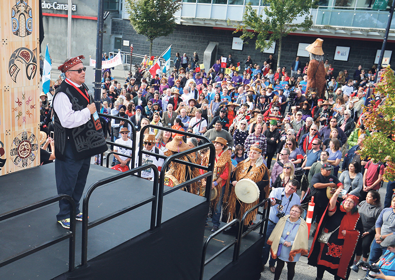 Chief Robert Joseph, Reconciliation Canada, addresses the crowd at the start of the 2017 Vancouver Walk for Reconciliation. supplied