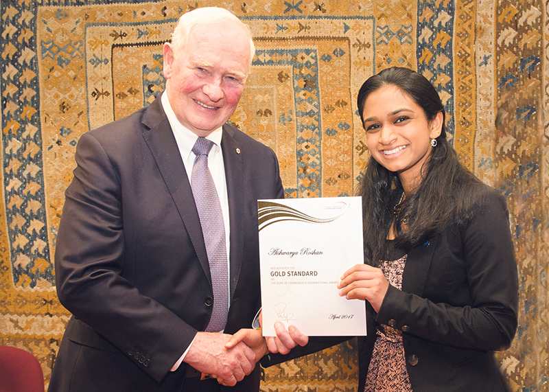 Aishwarya Roshan receives her Gold award from the former Governor General of Canada, David Johnston. supplied