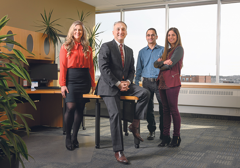 Giving back to the community enhances the engagement of employees, says Bernard Lord, CEO, Medavie, pictured second from left with employees (from left to right) Maureen Welsman, David Kabalen and Swati Bhuchar. supplieD