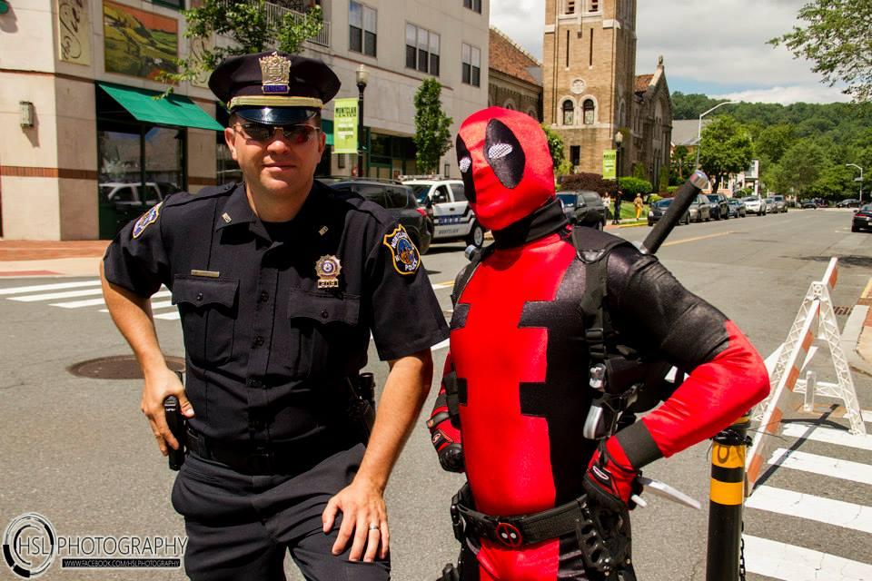 Deadpool and a cop.jpg