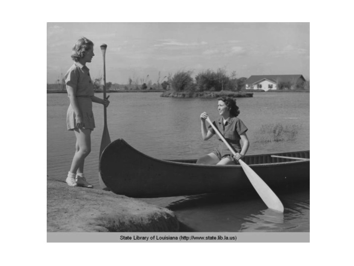 Canoeing on the lakes in Baton Rouge in the 1940s. The exact location is not identified.