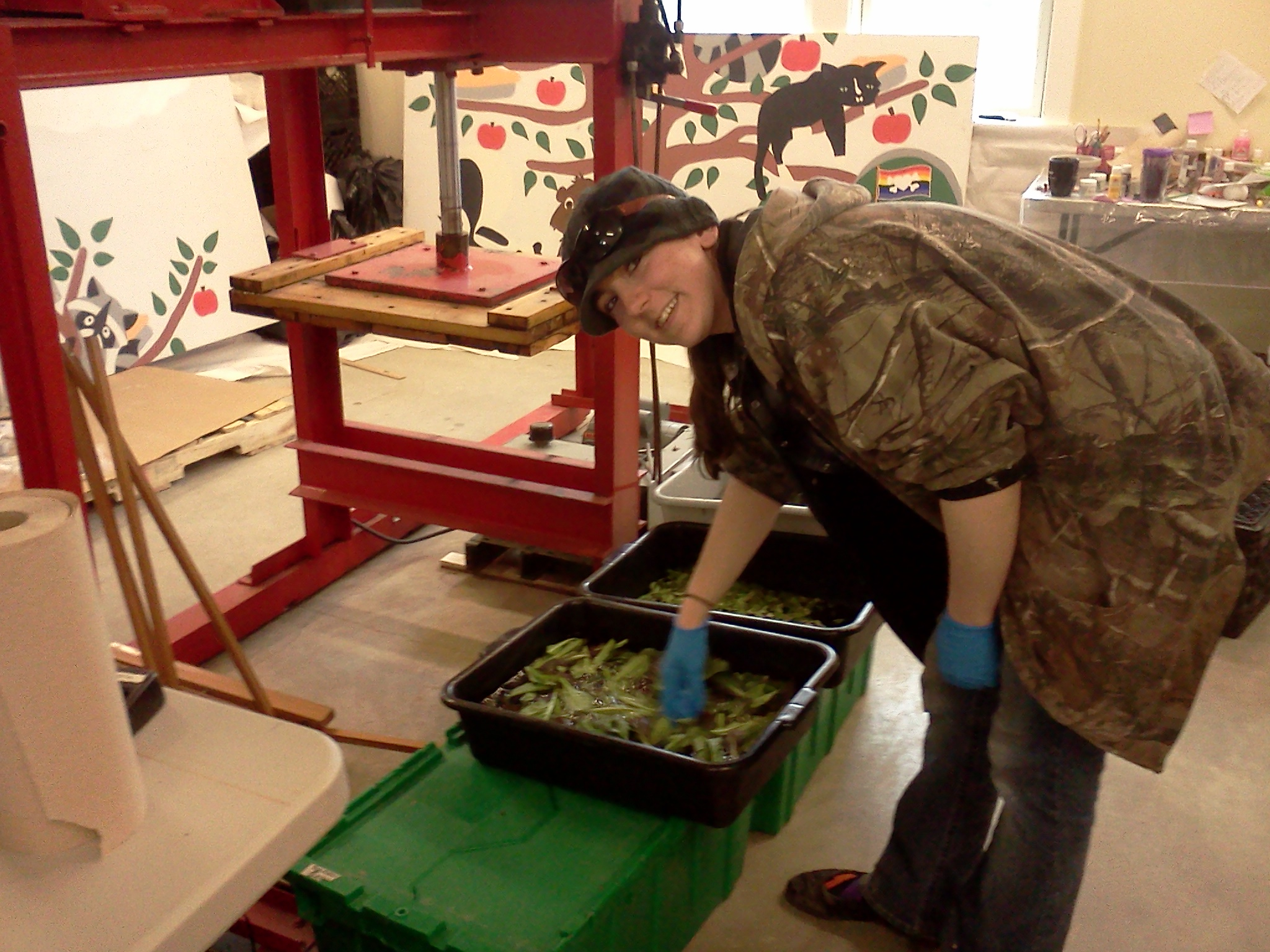 Here we see Christal, our packing house manager, cleaning the greens and preparing them for bagging.
