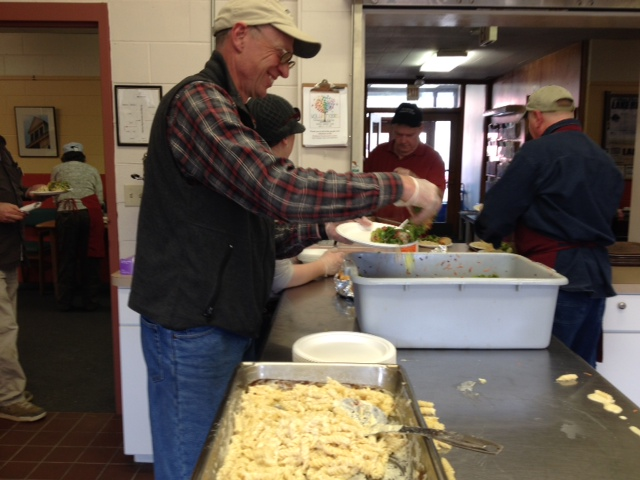 The Orchardist serves macaroni & cheese to hungry community members