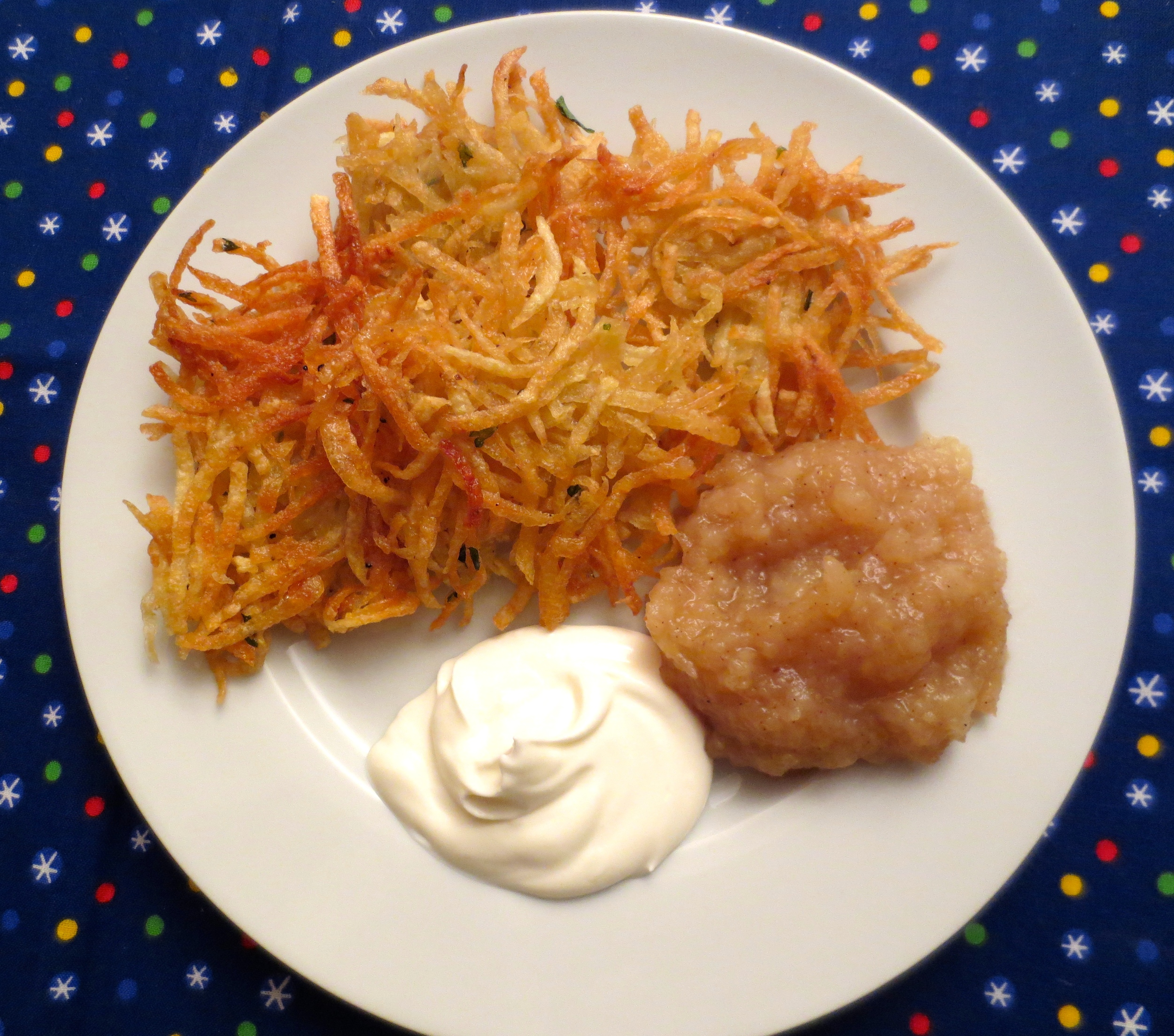 Finished latkes- served immediately with a side of fresh applesauce and sour cream. Enjoy!