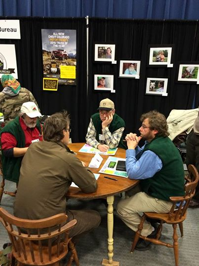 Farm Manager, Dan Cousins, on the far right, sits in on round table discussions at the Maine Farm Bureau table at the Ag Trade Show.