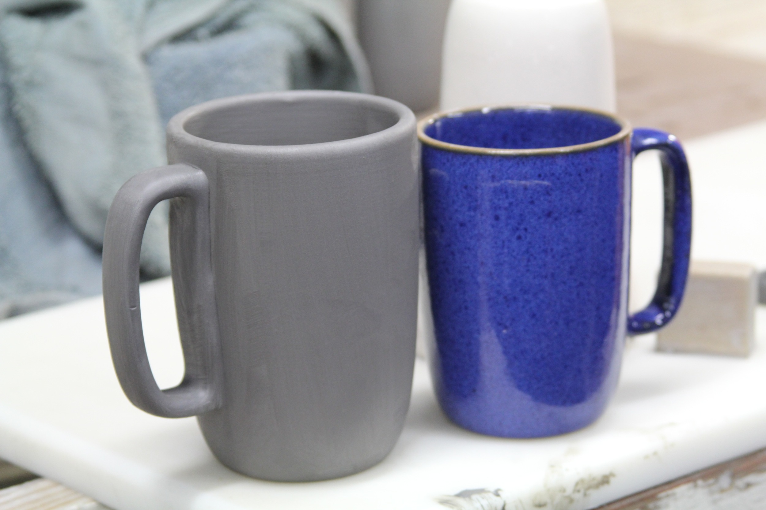 The mugs shrink significantly in size after a firing in the kiln.