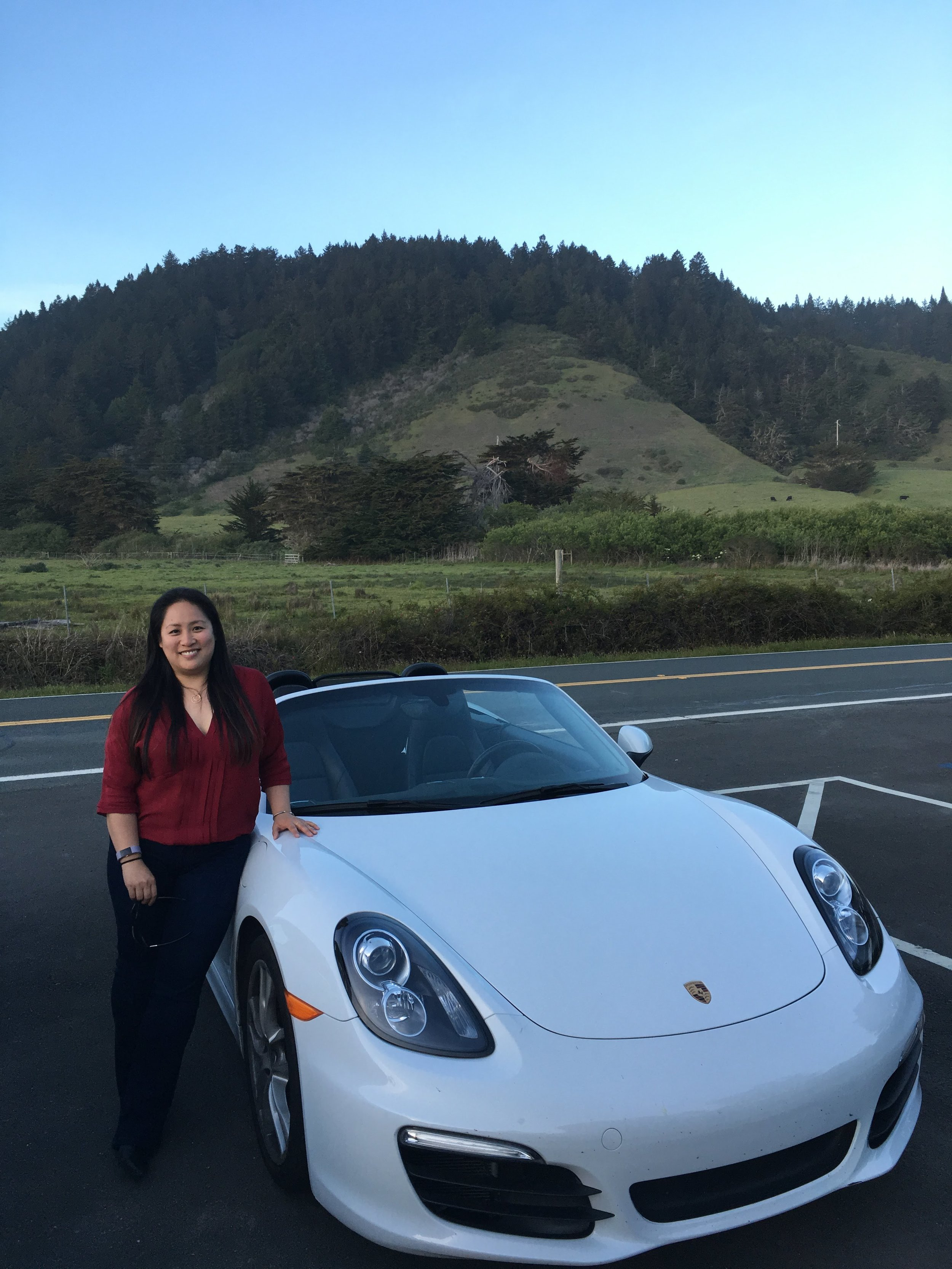 This photo of me and my convertible Porsche Boxster is like a unicorn—you probably won't ever see it again.