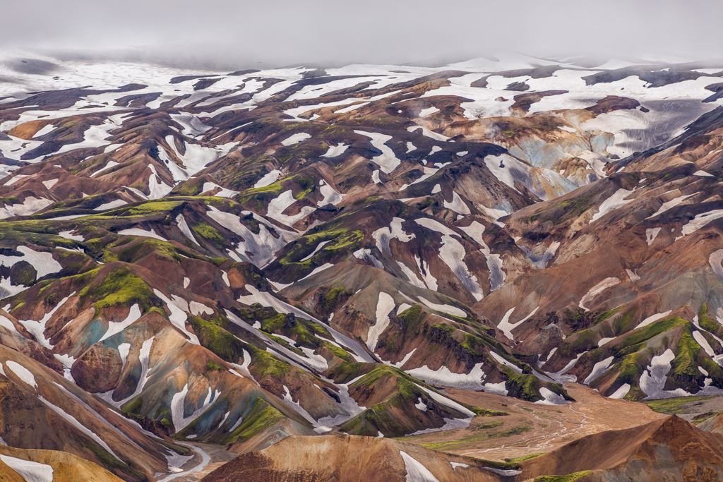 Colorful Rhyolith mountains with patches of snow