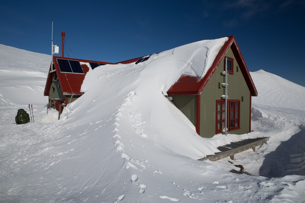 Hraftinusker hut covered by snow.
