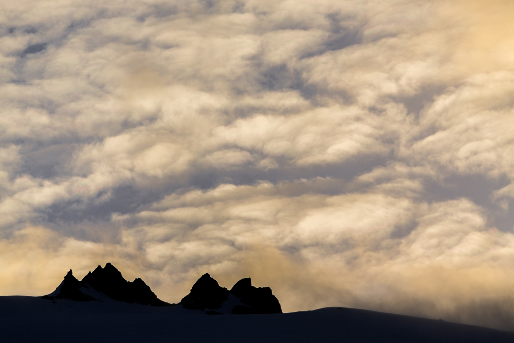 Moutain silhouette and clouds