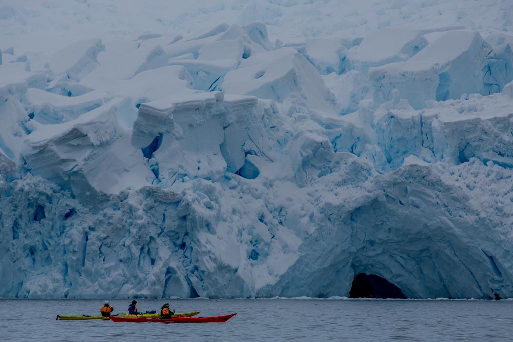 Kayaking below icefall