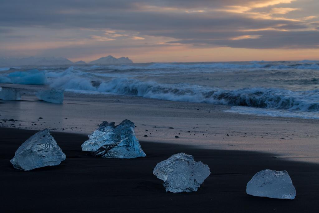 Blue icebergs on the black beach