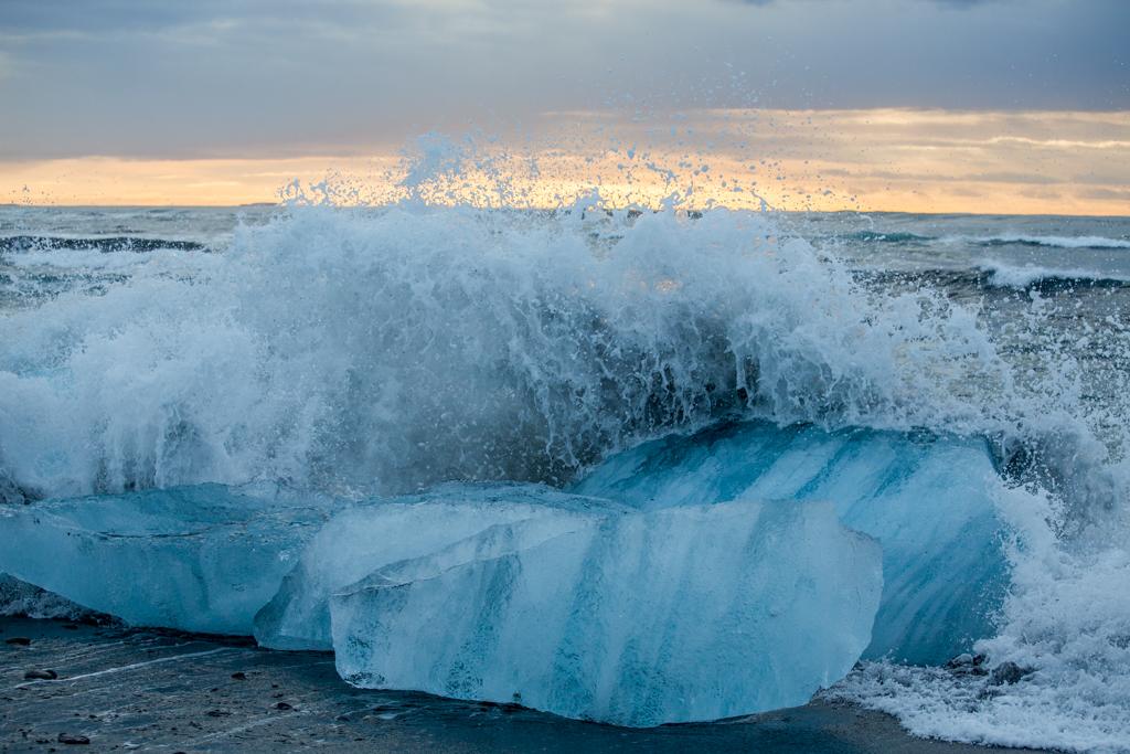Sunrise and a splashing iceberg
