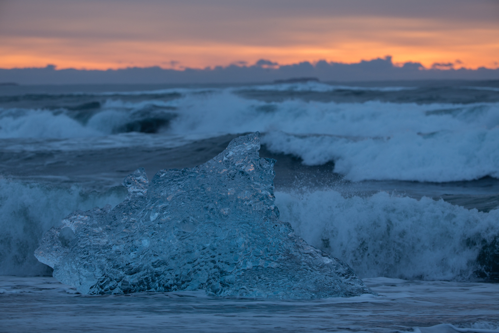Blue ice block with waves approaching