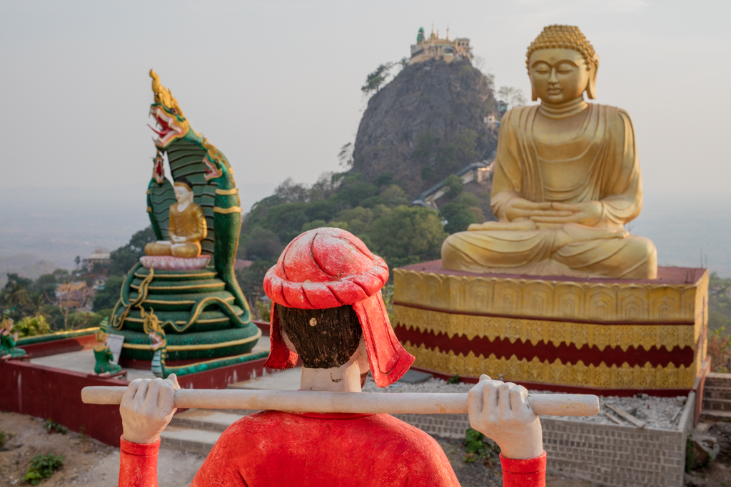 Colorful statues in front of Taung Kalat