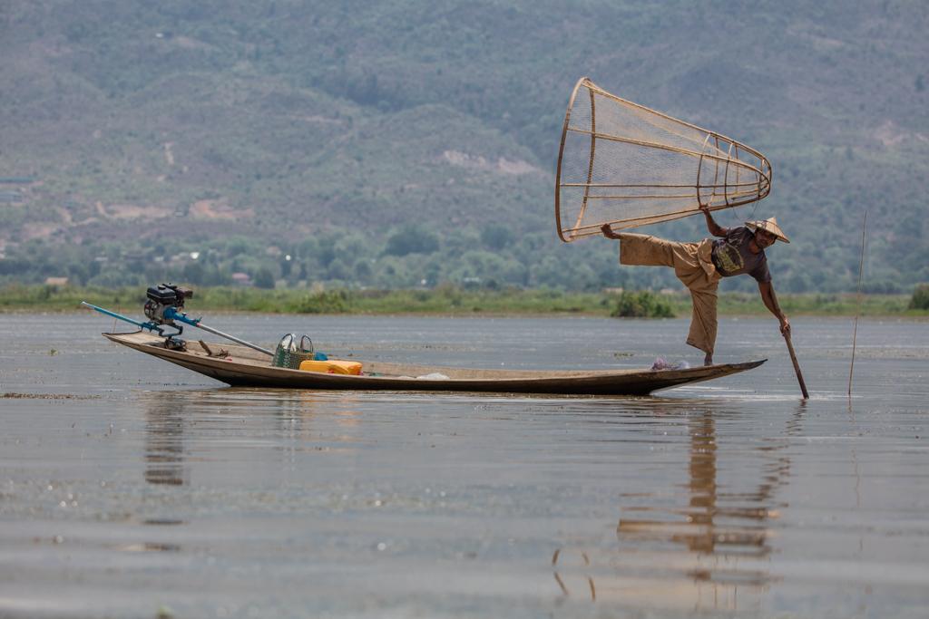 Fisherman with net on Inle Lake