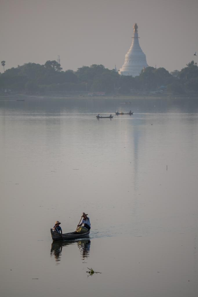 Boat Amarapura lake with pagoda