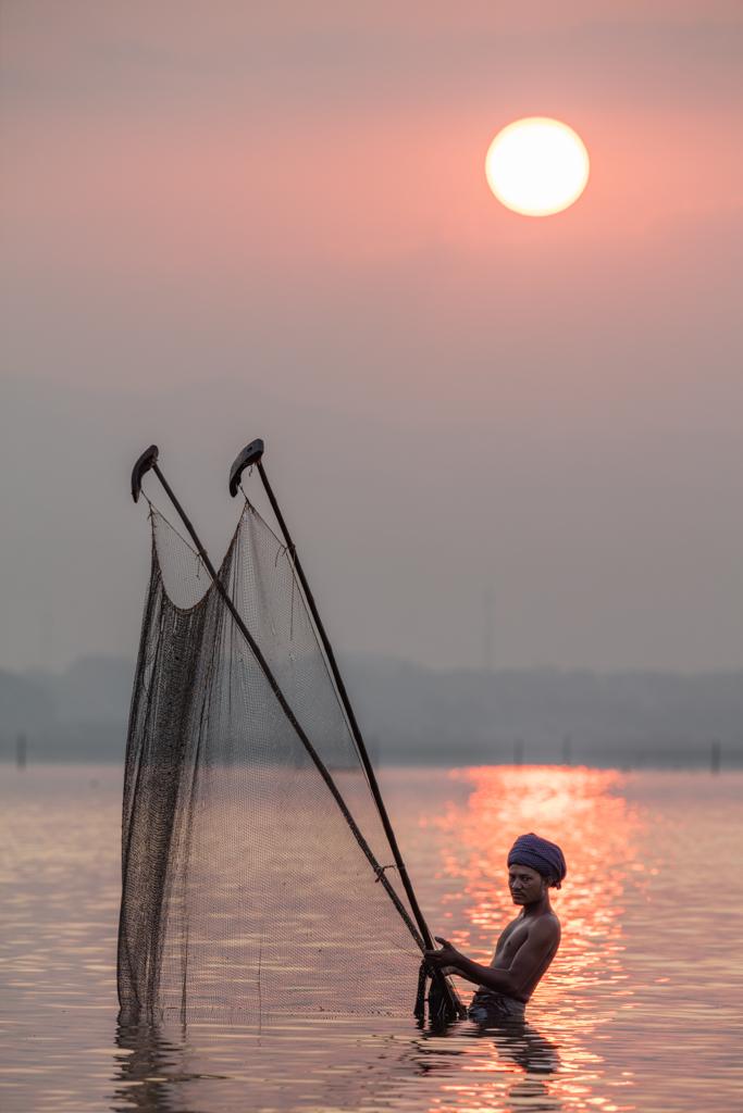 Fisherman at sunrise in Amarapura