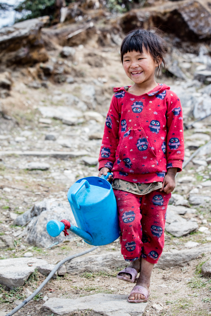Little girl with watering can