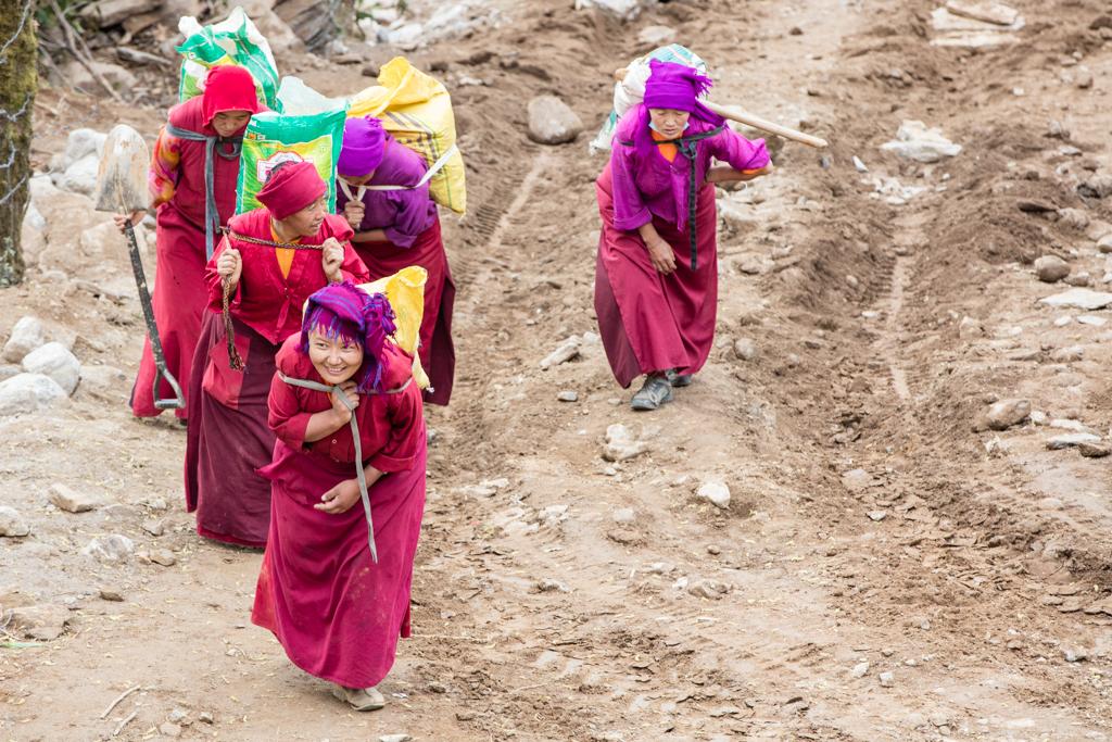 Working women rebuilding the monastery